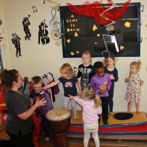 Educator and kids dancing