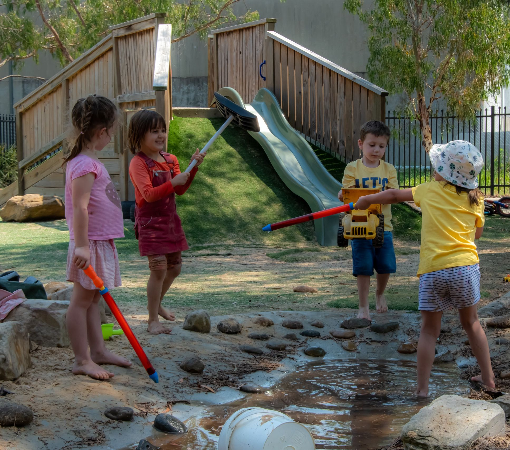Four kids playing in daycare playground
