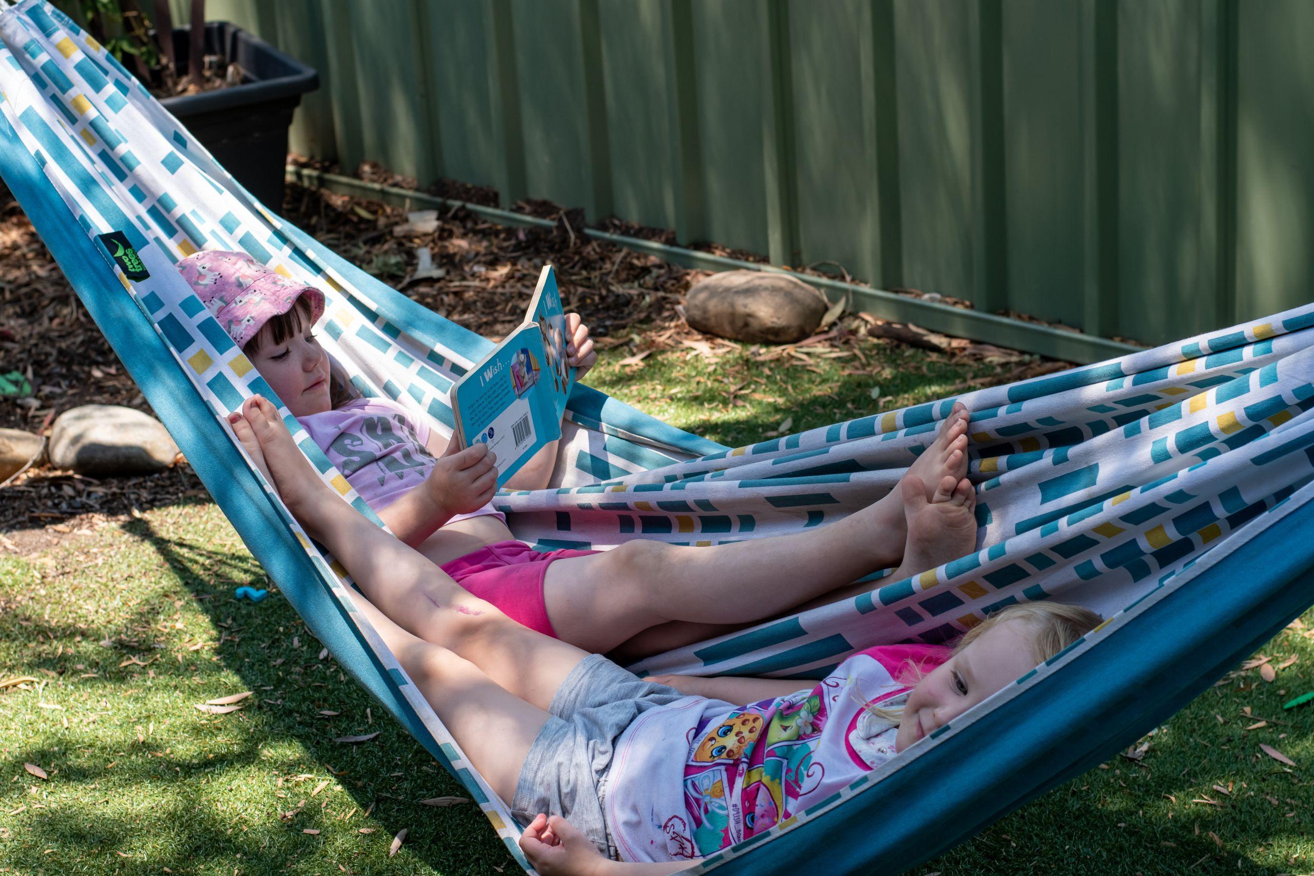 Child reading in hammock